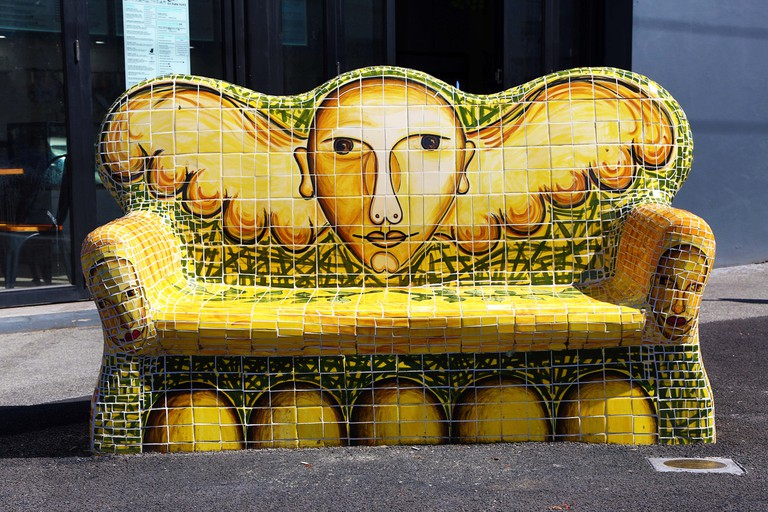 Decorated stone sofa on Brunswick Street, Melbourne, Victoria, Australia
