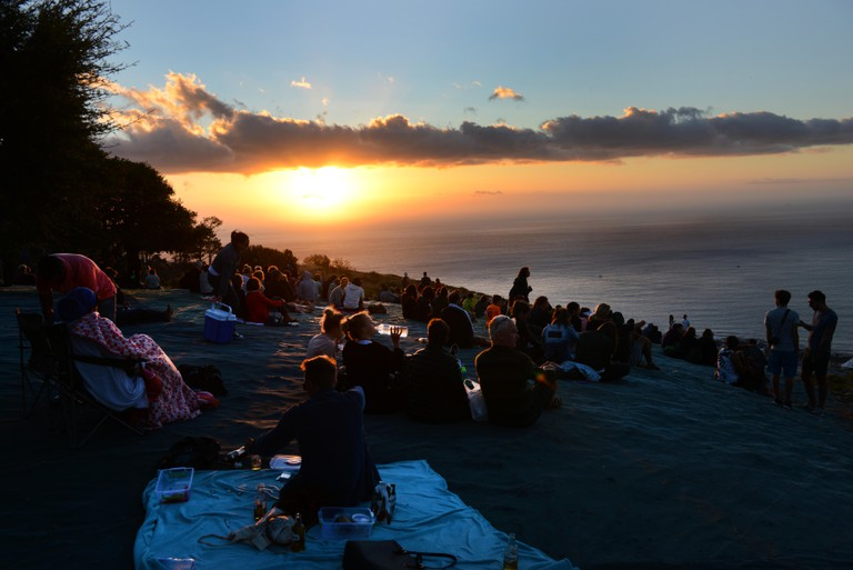 Locals and tourist enjoying the sunset from the top of Signal hill