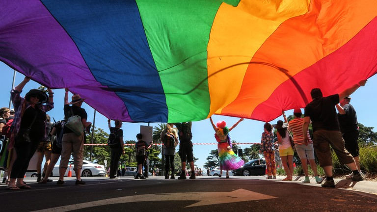 Melbourne Australia : The rainbow flag is proudly carried in a Gay Pride Parade through the streets of Melbourne.