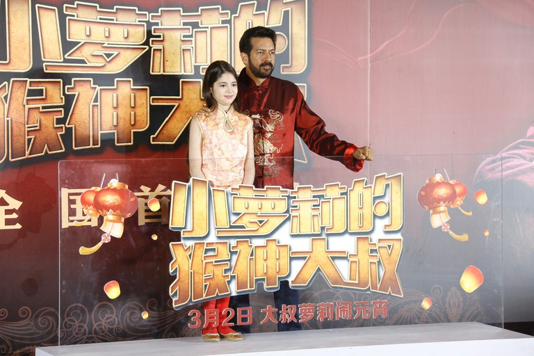 "Indian film director Kabir Khan, left, and child actress and model Harshaali Malhotra attend a premiere event for movie ""Bajrangi Bhaijaan"" in Beijing"