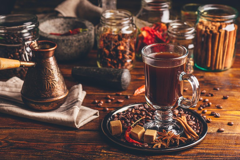 A Turkish cerzve and coffee cup with sugar and spices