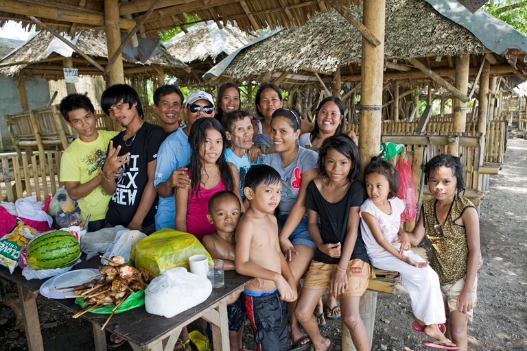 Large extended family portrait in Luzon, Philippines.