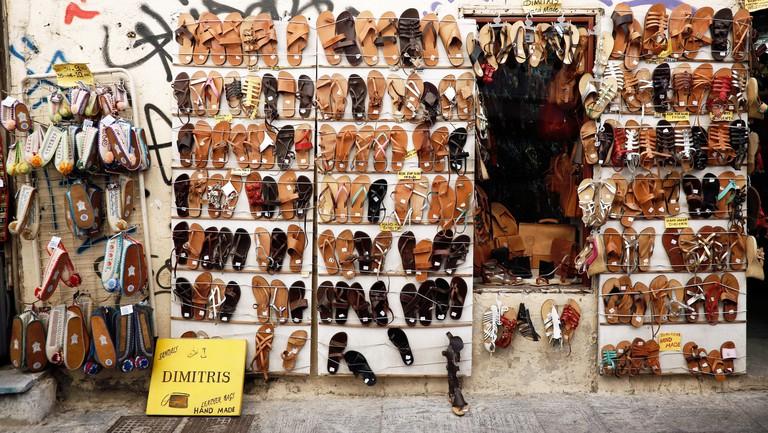 hop sells handmade leather sandals in historic Plaka neighborhood