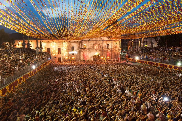 Santo Nino devotees attend mass by the thousands at the Basilica Minore del Santo Nino and wave their hands while singing 'Bato