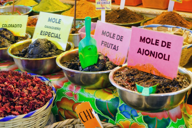 Different types of mole and spices in marketplace in downtown Oaxaca, Mexico