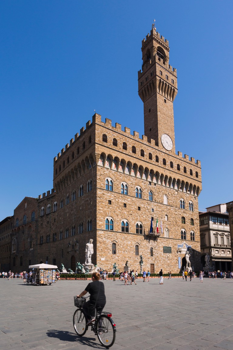 Florence, Florence Province, Tuscany, Italy. Palazzo Vecchio in the Piazza della Signoria. The Historic Centre of Florence is a UNESCO World Heritage