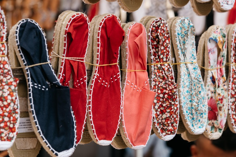 Colorful spanish handmade espadrilles on market stall
