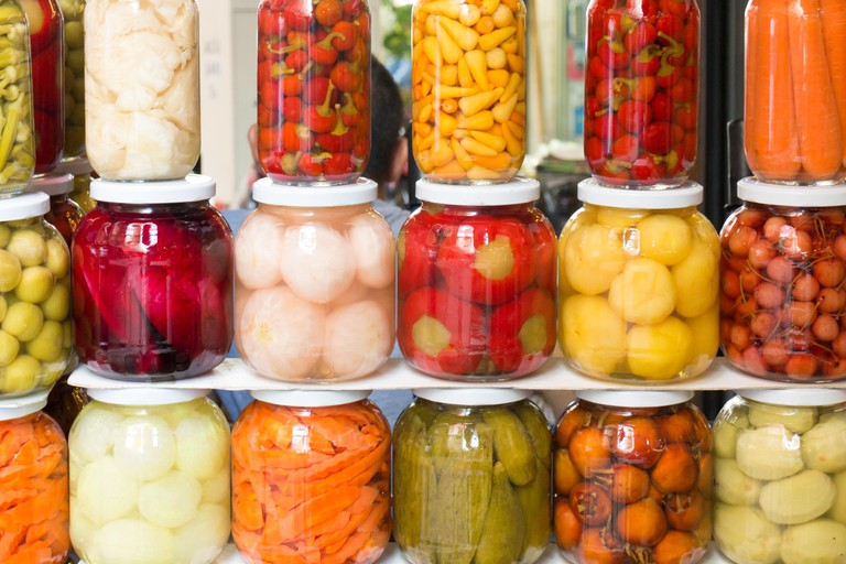 Jars of pickles and preserved vegetables for sale