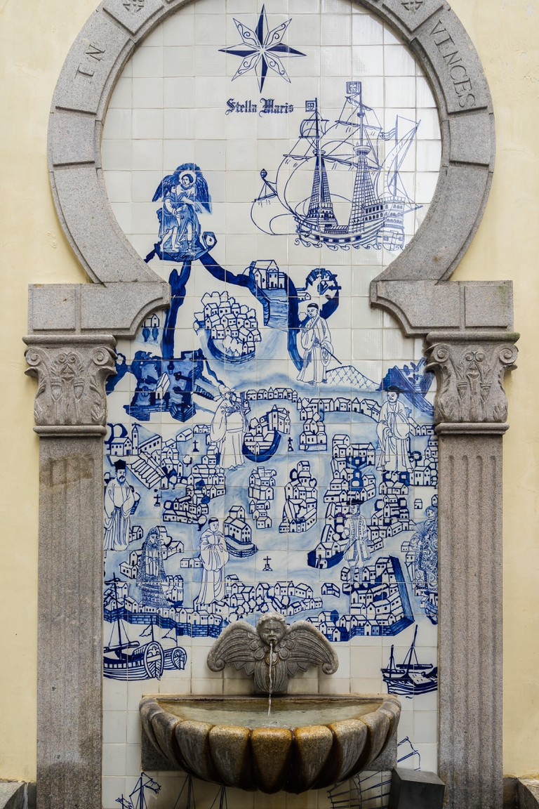 A small fountain in the historic centre of Macau with traditional 18th century blue and white tiles