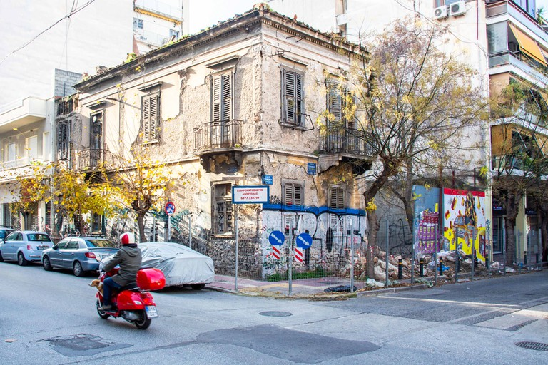 Old and new buildings line the streets of the Metaxourgeio district of Athens, Greece