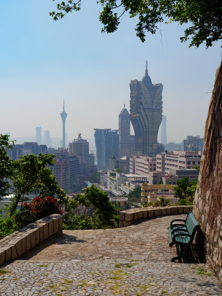 The futuristic skyline of Macau during the day.