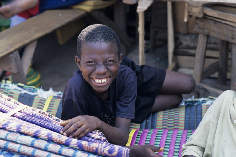 Boy in the market at Serrekunda near Banjul in Gambia. Image shot 2005. Exact date unknown.