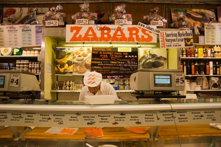 Salesman at the fish counter at Zabar's West Side Delicatessen New York USA