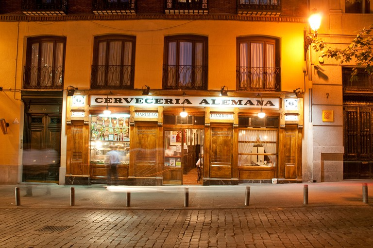 Facade of Cerveceria Alemana, night view. Santa Ana Square, Madrid, Spain.