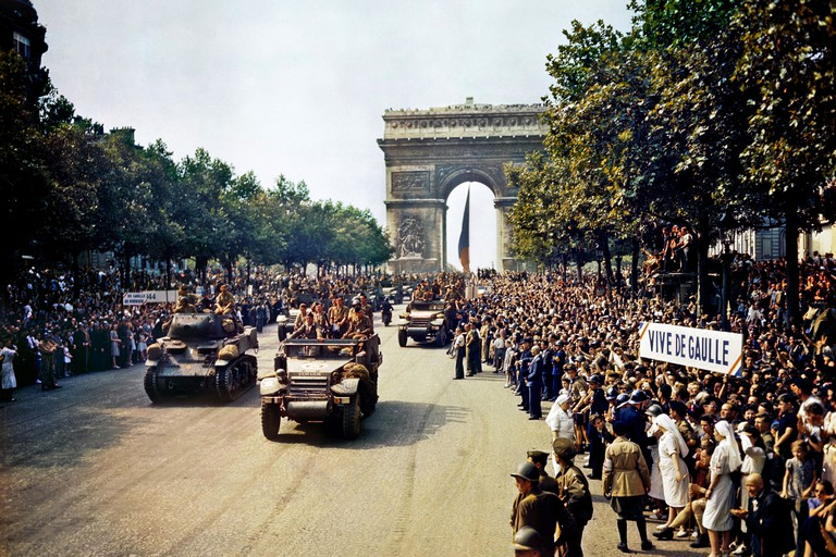 Colour photograph of the American army passes crowds of French patriots line in the Champs Elysees, Paris. Dated 1944. Image shot 1944. Exact date unknown.