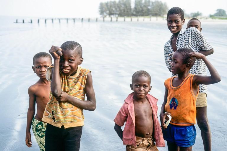 Gambian children having fun on beach, Gambia, West Africa