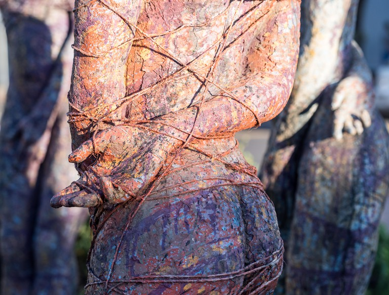 Sculpture of life size women in the center of Stellenbosch, South Africa.