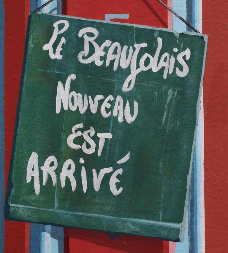 A sign saying that the latest Beaujolais Nouveau wine has arrived
