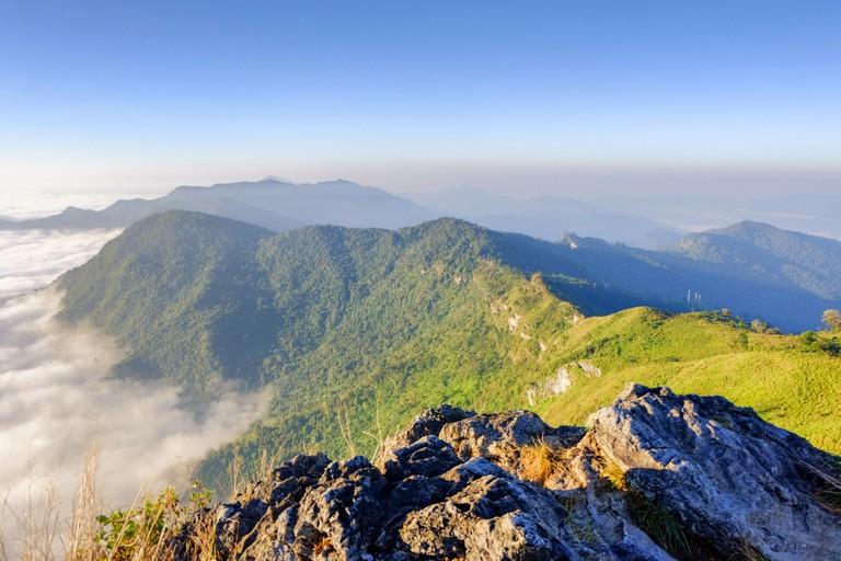 a sunrise over the fog in phu chi fah mountain