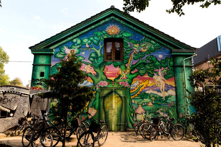 A building façade with street art seen at the freetown Christiania on August 31, 2019 in Copenhagen, Denmark.
