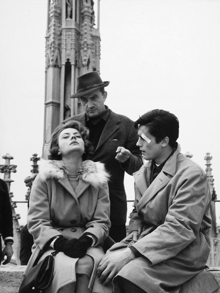 "Annie Girardot, Luchino Visconti, Alain Delon on the set to film ""Rocco e i suoi Fratelli"" 1960"
