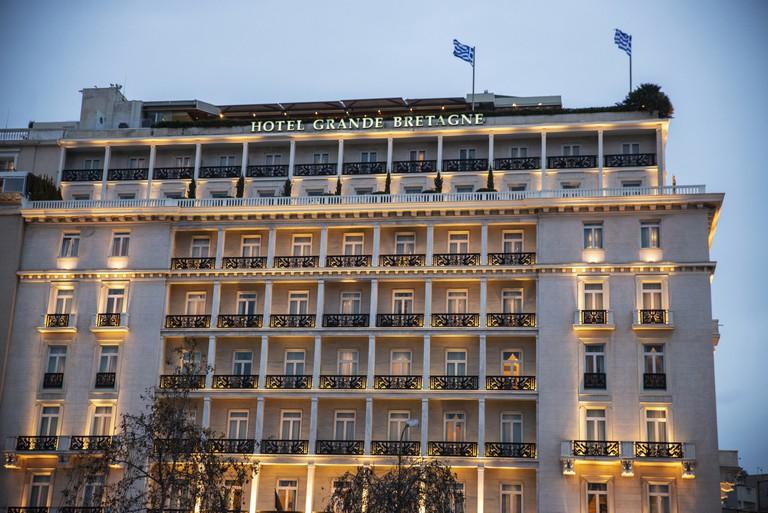 Grande Bretagne hotel at night in Athens, Greece
