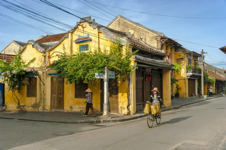 Woman Driving Bicycle in Hoi An