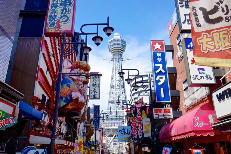 Color signs and Tsutenkaku Tower in south Osaka