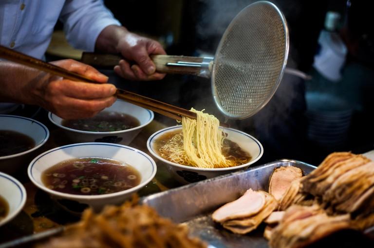 Preparing steaming ramen in Japan