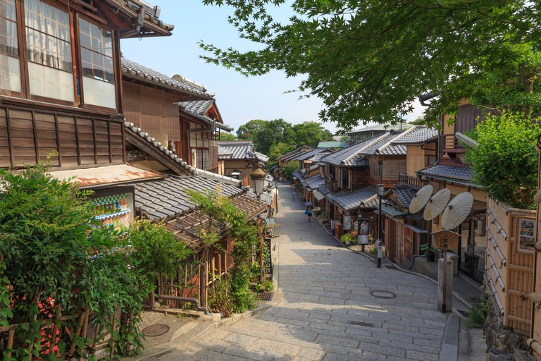 Street scenes with traditional Japanese house and tree in Kyoto