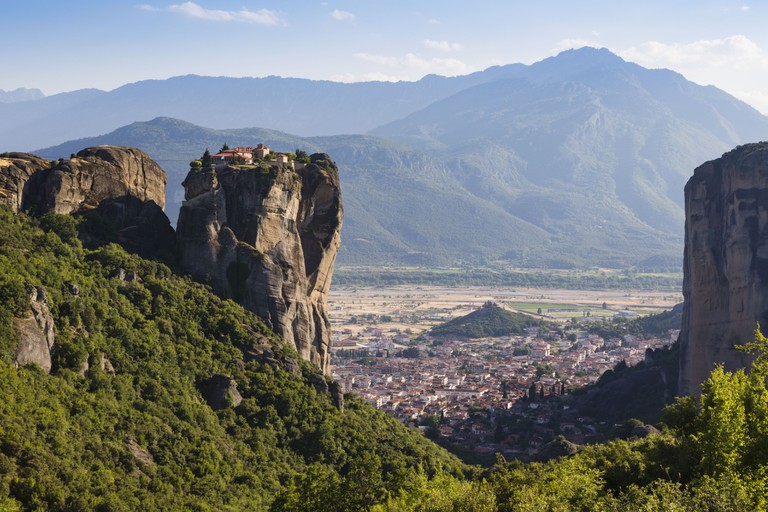Meteora, Thessaly, Greece, The Eastern Orthodox Holy Trinity Monastery, Kalambaka can be seen on the plain below
