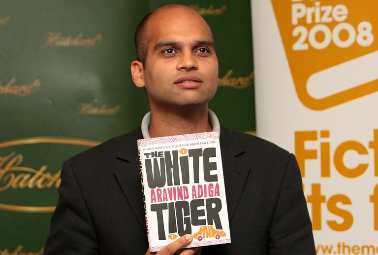 "Aravind Adiga with his book ""The White Tiger"", 2008"