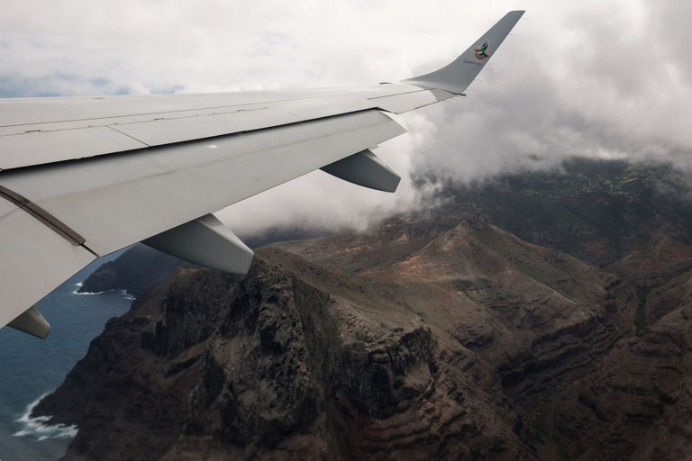 The dramatic topography of the island is seen from the window of a passenger plane as it takes off from St Helena airport
