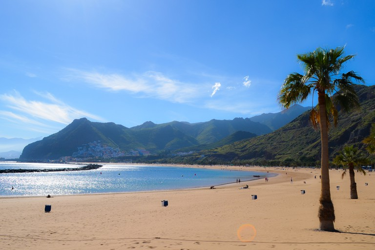 Beach in holiday resort on sunny day, Santa Cruz de Tenerife, Tenerife, Spain