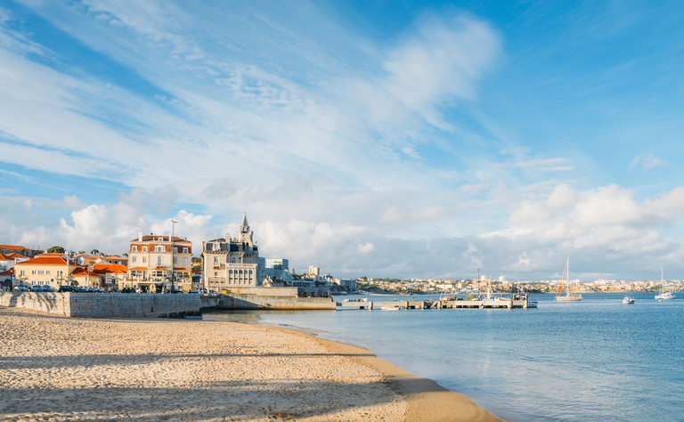 Panoramic view of Praia da Ribeira, Cascais, Portugal, an intimate beach near the train station and popular with tourists