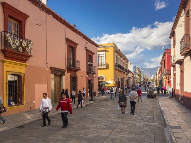 People walking on Calle Alcala, a pedestrian street in center Oaxaca City Mexico
