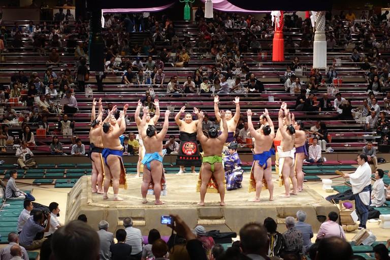 dohyo-iri (ring-entering ceremony) during a honbasho (???) at Ryogoku Kokugikan (?????) by rikishi (sumo wrestlers).
