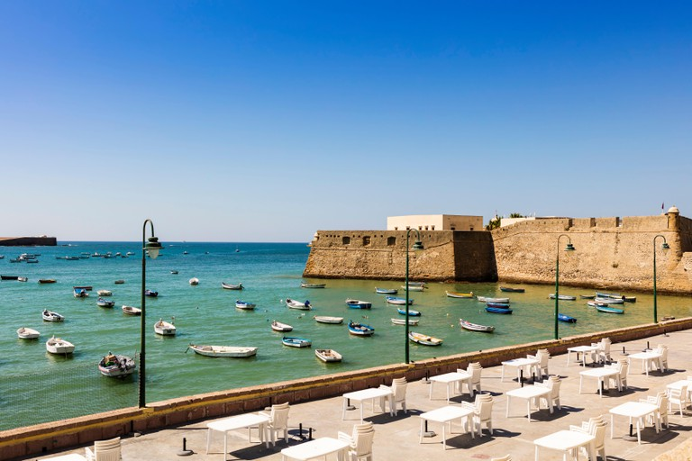 Seafront with a view of medieval Castle of Santa Catalina, Cadiz