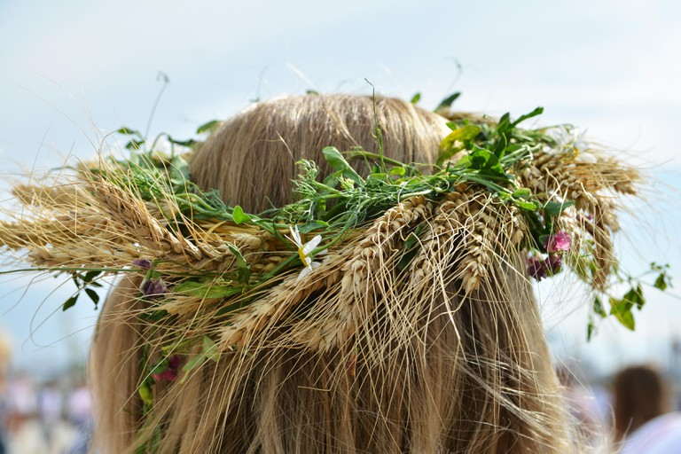 Traditional crown of flowers at International Blouse Day in Dobrogea , Romania