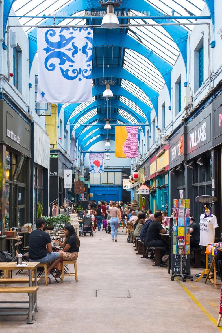 Interior view of the indoor Brixton Village Market