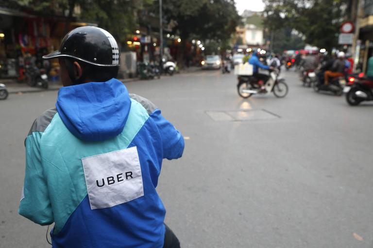 Motorbike uber driver.  Hanoi. Vietnam. | usage worldwide