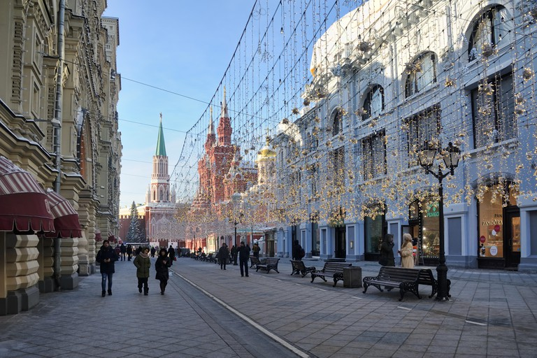 = Walking Under Garlands at Nikolskaya =View from a corner of GUM building on Nikolskaya street decorated with a lot of garlands illuminating the fe