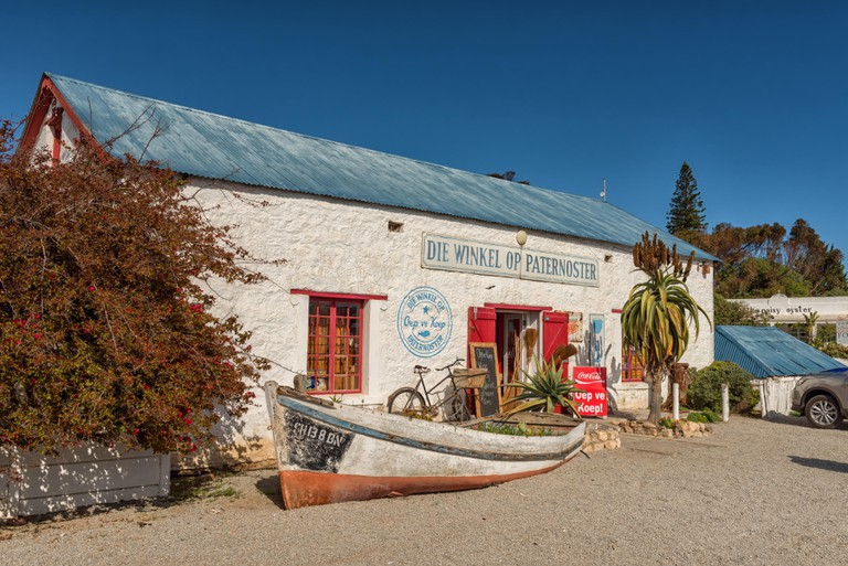 PATERNOSTER, SOUTH AFRICA, AUGUST 21, 2018: Die Winkel Op Paternoster, a shop in an historic building in Paternoster on the Atlantic Ocean Coast. A bo