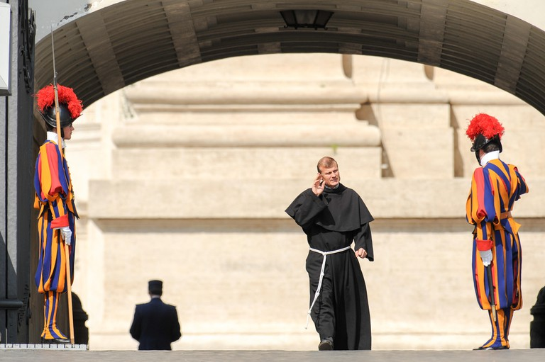 A member of the Pontifical Swiss Guard at the entrance to Vatican