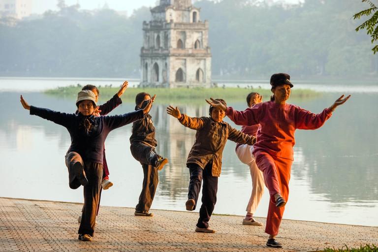 Hanoi, Vietnam; Early morning Tai Chi near Hoan Kiem lake