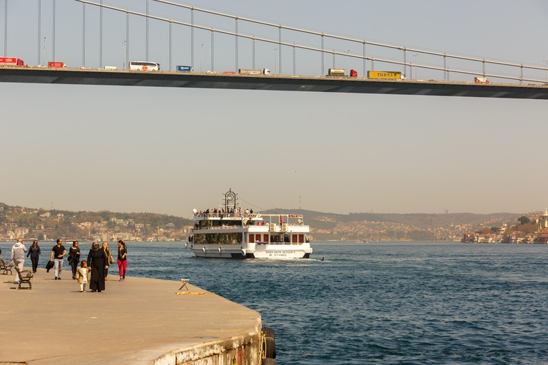 Tourists take a boat tour on the Bosporus in Istanbul