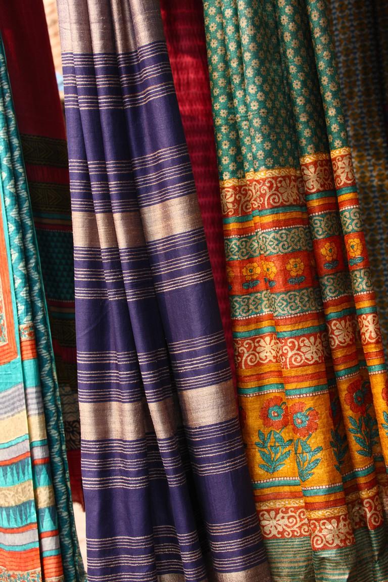 Saris in a clothing store, Dilli Haat, New Delhi, India