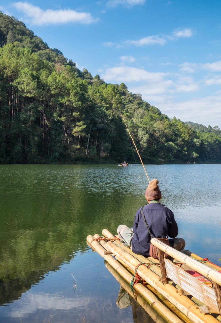 Villager fishing on reservoir in sunny at pang oung,mae hong son, Thailand.