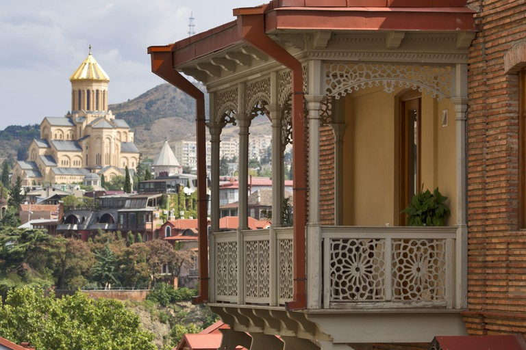 August 27th 2019, Georgia: Tbilisi - typical balconies and Sameba cathedral