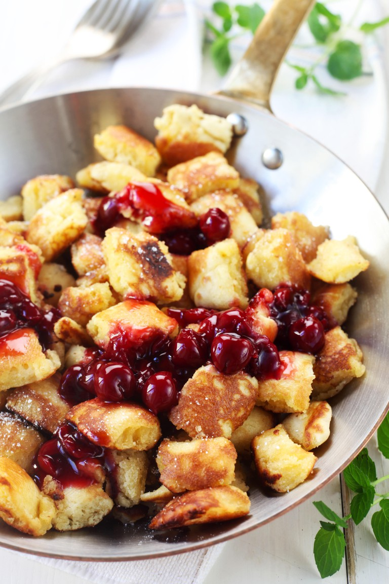 Traditional Austrian Kaiserschmarrn With Cherries In A Copper Pan
